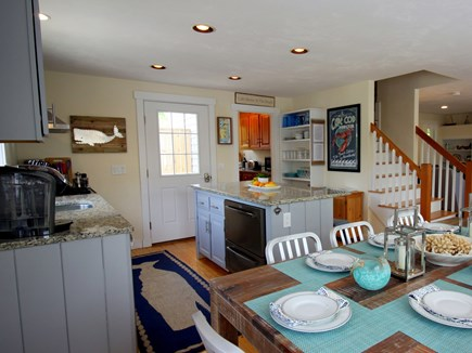 Chatham downtown village Cape Cod vacation rental - New appliances & granite.  Open shelving filled with dishware.