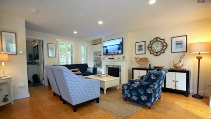 Chatham downtown village Cape Cod vacation rental - Open living room w/ fireplace and 55 inch TV (cable and Wifi)