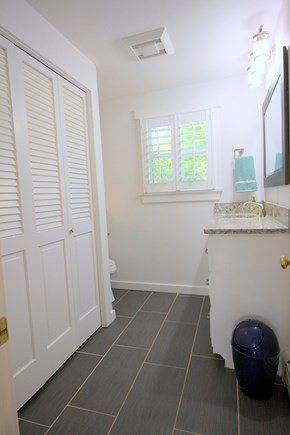 Chatham Village Cape Cod vacation rental - Main floor bathroom and laundry room (renovated Spring 2016)