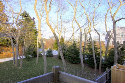 Chatham Village Cape Cod vacation rental - Lookout queen bedroom balcony has seasonal filtered ocean views