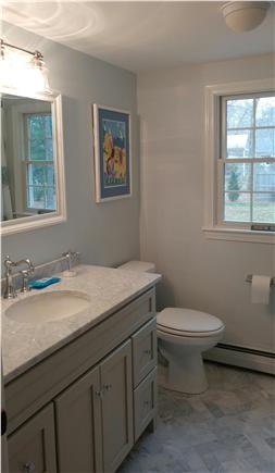 Eastham Cape Cod vacation rental - First floor marble floor and countertop bathroom with tub