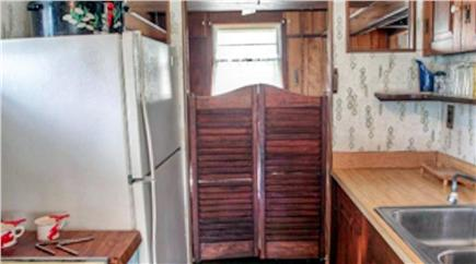 Plymouth MA vacation rental - Looking into kitchen/galley, past saloon doors is the bedroom