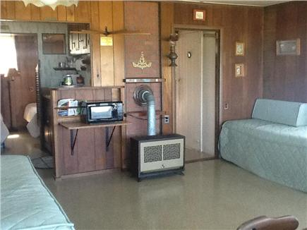 Plymouth MA vacation rental - View of living room with 2 day beds,looking into kitchen & bathrm