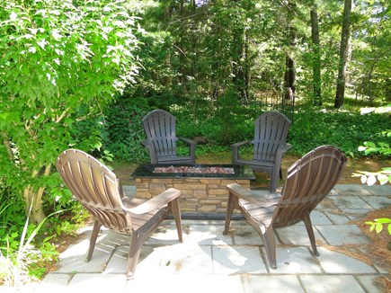 Orleans Cape Cod vacation rental - Back patio with fire pit, great place to relax; private back yard