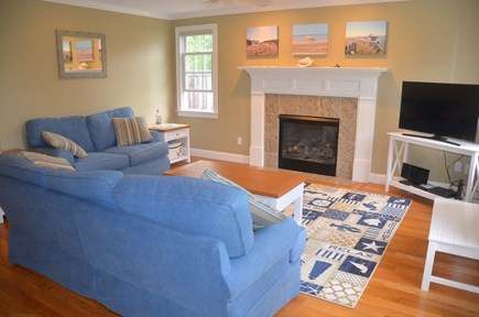 North Eastham Cape Cod vacation rental - Living room with gas fireplace and smart TV
