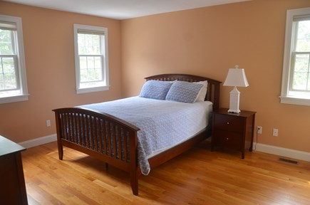 North Eastham Cape Cod vacation rental - First floor bedroom with hardwood floor and queen size bed