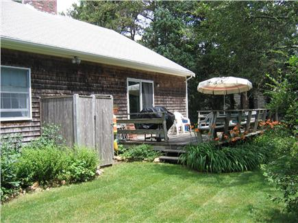 Brewster Cape Cod vacation rental - Backyard with outdoor shower and deck.