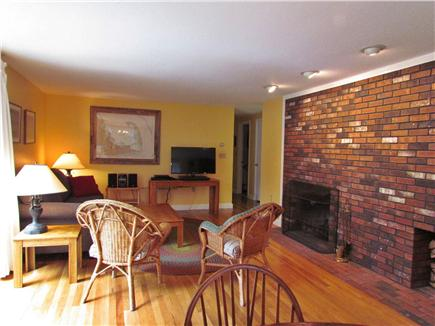Brewster Cape Cod vacation rental - Front room with fireplace.
