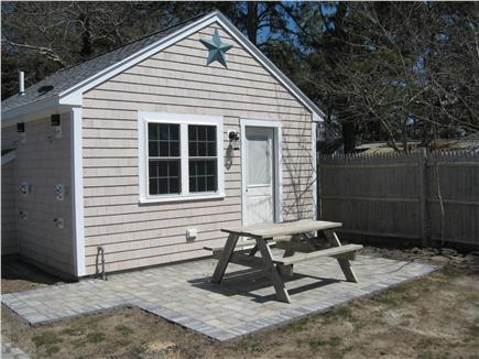 Dennis Port Cape Cod vacation rental - Front view with patio and picnic table