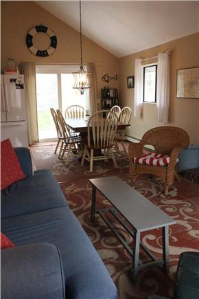 Eastham Cape Cod vacation rental - Large living/dining room with cathedral ceiling, slider to deck.