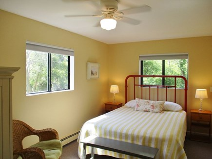 Eastham Cape Cod vacation rental - Downstairs front bedroom features queen bed with brass headboard.