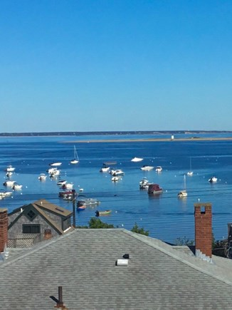 Provincetown Cape Cod vacation rental - Watch Provincetown Harbor boating activity from your deck .