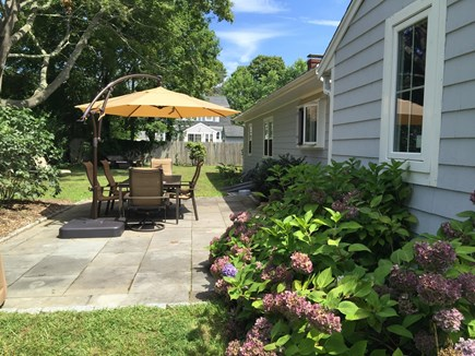 Falmouth Village Cape Cod vacation rental - Spacious back yard with blue stone patio and seating for 6