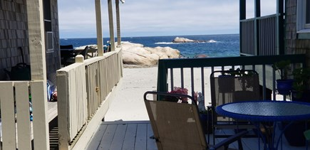 Scituate MA vacation rental - Enjoy coffee or cocktails on the porch with a view of the ocean.