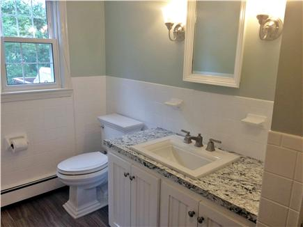 Dennis Cape Cod vacation rental - First floor renovated full bathroom with tub and shower.