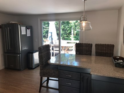 Dennis Cape Cod vacation rental - Breakfast bar in the kitchen leading out to the deck.