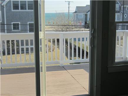 Falmouth Cape Cod vacation rental - View to ocean across upper deck from the upstairs double bedroom