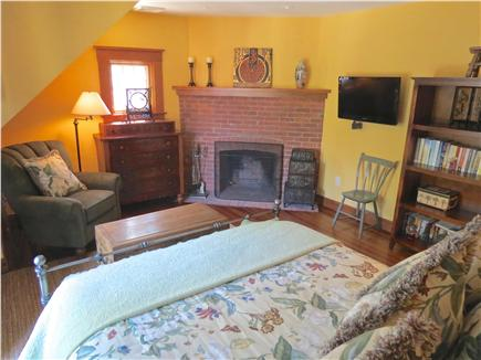 Orleans Cape Cod vacation rental - BR #2 with queen bed and fireplace.  BR#3 also is a queen