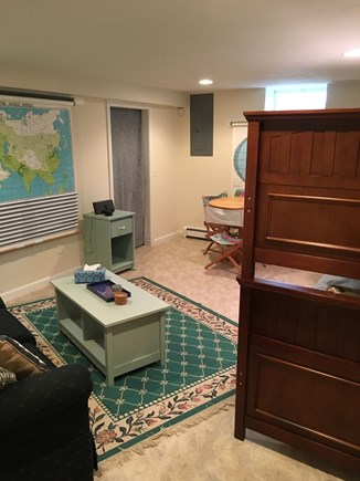 N FALMOUTH Cape Cod vacation rental - The Map Room w/twin The Map Robunk beds and a queen sleeper sofa.