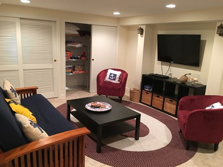 N FALMOUTH Cape Cod vacation rental - Downstairs Media Room with 55 inch TV, DVD and family board games