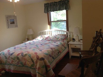 N FALMOUTH Cape Cod vacation rental - Master Bedroom w/queen bed with attached 1/2 bath ample storage.