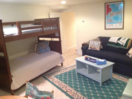 N FALMOUTH Cape Cod vacation rental - The Map Room w/twin bunk beds and a queen sleeper sofa.