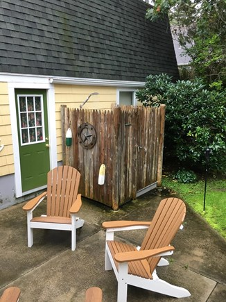 N FALMOUTH Cape Cod vacation rental - Large outdoor shower with 4 Adirondack chairs.