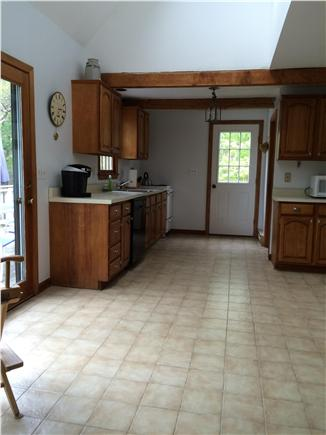 Truro Cape Cod vacation rental - Kitchen ~ French door to deck (seats 6-8) pantry & 4 burner stove