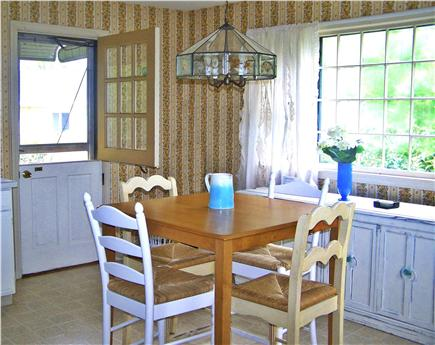Harwich Cape Cod vacation rental - High top dining area with Dutch door opening to back yard