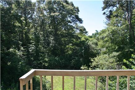Brewster Cape Cod vacation rental - The deck overlooks a big back yard...