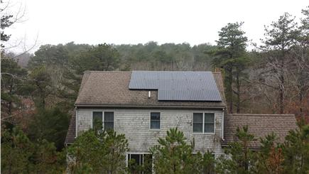 Wellfleet Cape Cod vacation rental - Back of house with solar panels on right