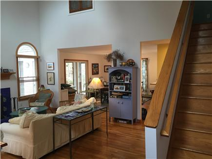 Wellfleet Cape Cod vacation rental - Living room with dining room and door to sun porch in background