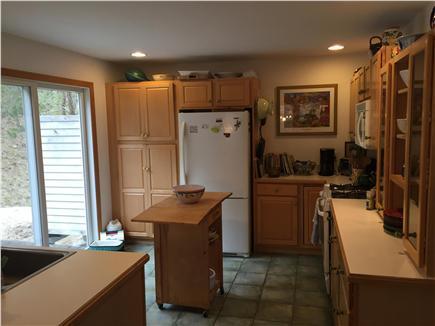 Wellfleet Cape Cod vacation rental - Kitchen looking towards doors to back deck and outdoor shower