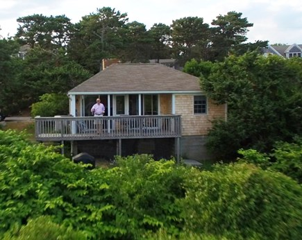 South Chatham Cape Cod vacation rental - A mid-air view of the deck which over looks the ocean.