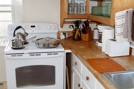 South Chatham Cape Cod vacation rental - Compact kitchen does the job. All-clad pots and new dishwasher.