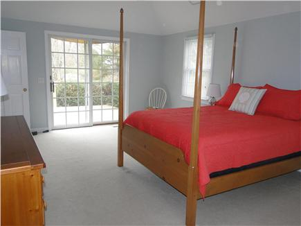 Eastham Cape Cod vacation rental - Master bedroom with sliding glass doors to large deck