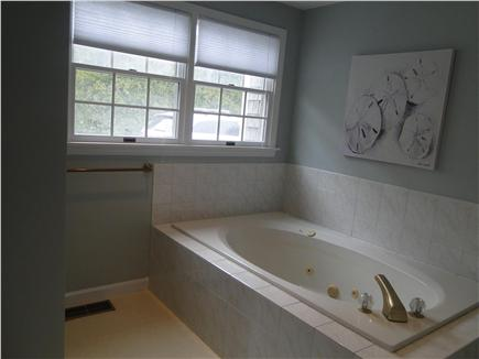 Eastham Cape Cod vacation rental - Master bath with jacuzzi tub & stand-up shower