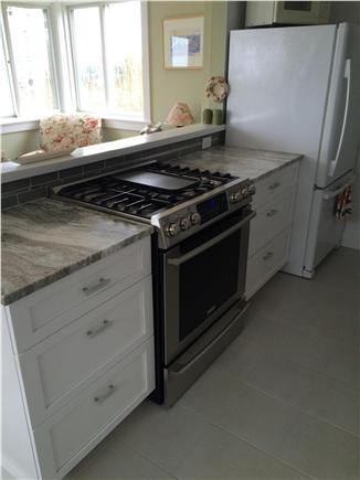 Provincetown, west end Cape Cod vacation rental - Kitchen with 5 burner stove and warming drawer