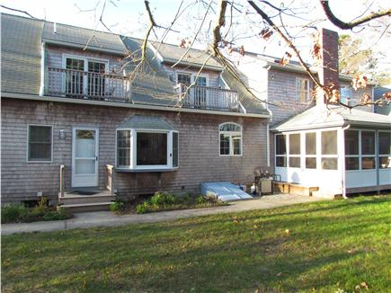 Brewster Cape Cod vacation rental - Back yard. Second floor decks, screened in porch,  grilling area.