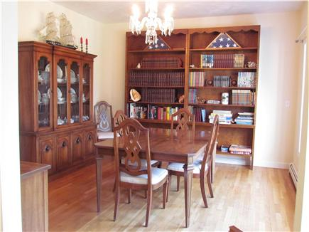 Brewster Cape Cod vacation rental - Formal sunny dining room, table has two leaves for extra seating.