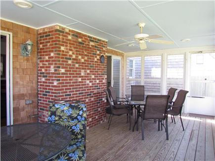 Brewster Cape Cod vacation rental - Screened in porch with tables and seating.
