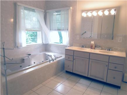 Brewster Cape Cod vacation rental - Master bath with Jacuzzi and walk in shower.