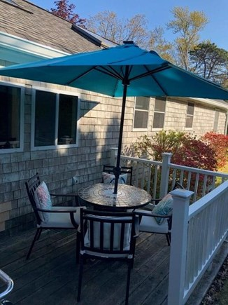 Centerville, Hyannis Port Cape Cod vacation rental - Deck with gas grill, table, chairs, solar-lit umbrella.