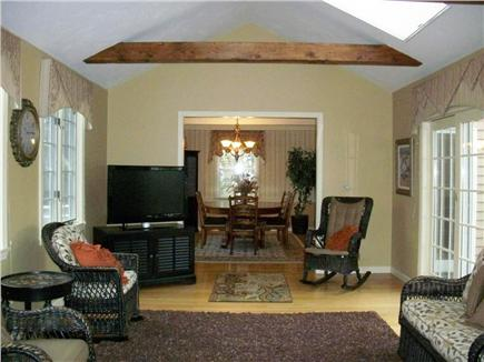South Yarmouth Cape Cod vacation rental - Family Room view of Dining Room and sliders to Deck