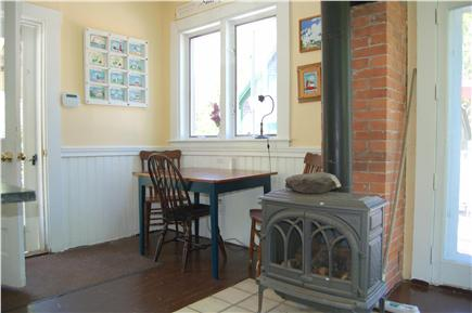 Barnstable Cape Cod vacation rental - Wood burning stove and small table in kitchen.