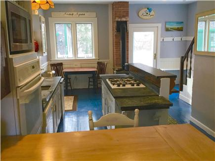 Barnstable Cape Cod vacation rental - Kitchen with view to antique barn and back deck