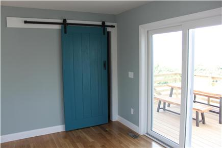 west yarmouth Cape Cod vacation rental - Barn door hides the laundry room