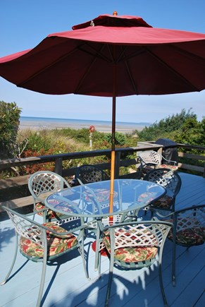 North Eastham Cape Cod vacation rental - Deck with seating arrangement, outdoor grill & fantastic bay view