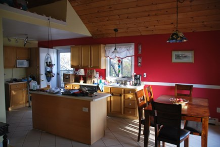 North Eastham Cape Cod vacation rental - Kitchen with open dining area (4 chairs and a bench for 2)