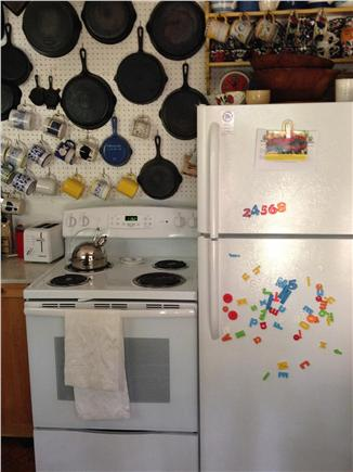 Truro Cape Cod vacation rental - New stove and fridge in the kitchen. Plenty of cast iron.